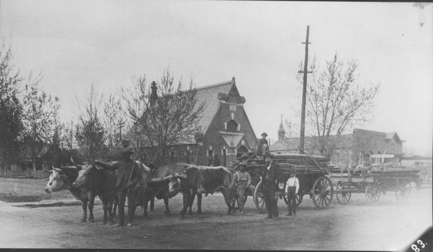 Freight wagon in front of Methodist Church at 5th and Main Street, ca. 1865; Copyright Royal Gorge Regional Museum & History Center