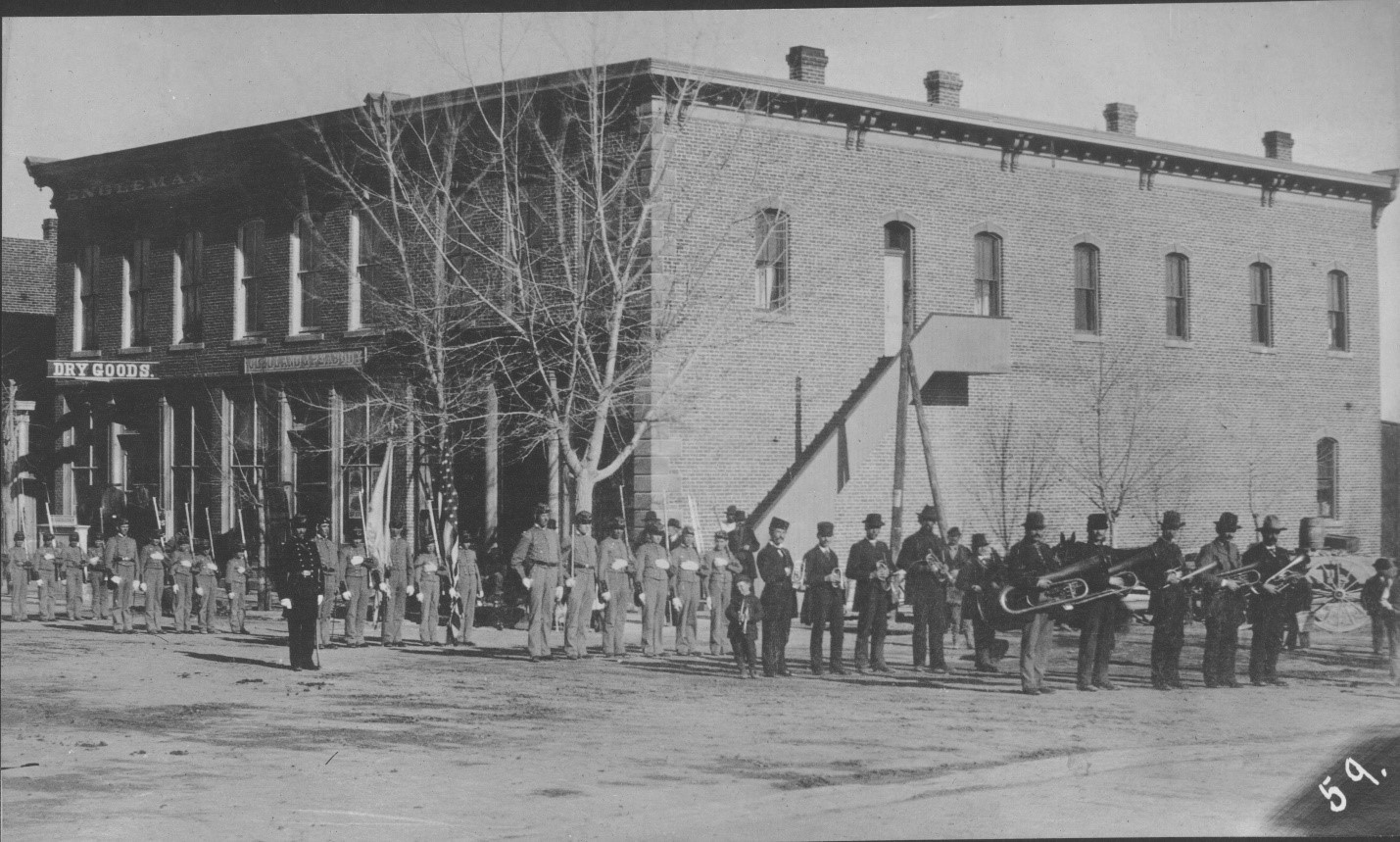 Southeast corner of 4th and Main Street with the old Cañon City band and Military Cadets, ca. 1884. Object ID: 1986.043.059; Copyright Royal Gorge Regional Museum & History Center